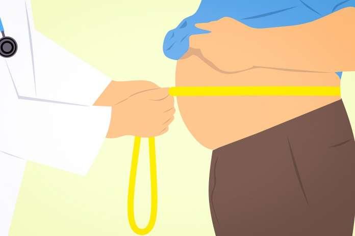 doctor measuring obese man